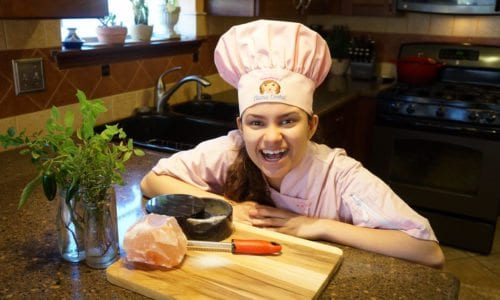 Kid Chef Eliana with Pink Himalayan Salt Rock and Herbs from her Garden 2016